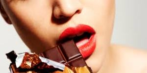 woman eating chocolate courtesy of Huffington Post