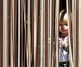 boy in curtains courtesy of 123rf.com